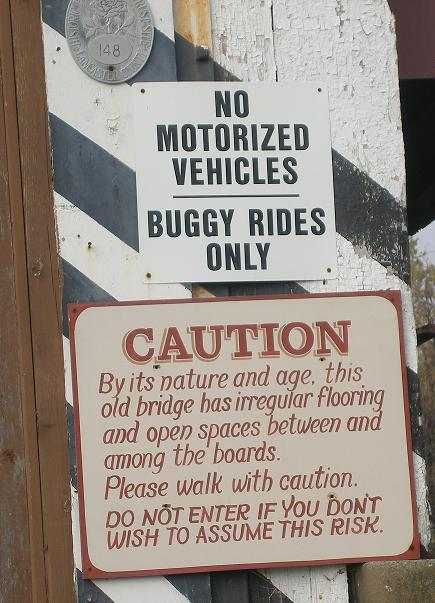 signs on historic covered bridge in Lancaster, PA