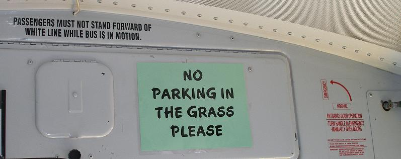 Signs in the front of a bus