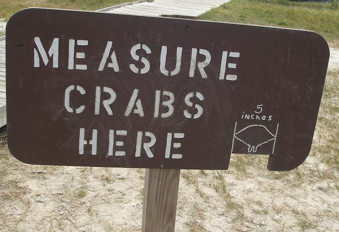 a crab measuring sign at a park